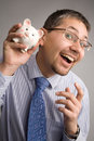 Holding a piggy bank Stock Images