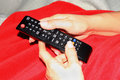 Holding remote control with two hands Royalty Free Stock Photo