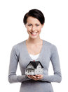 Holding small toy house in front of herself Royalty Free Stock Photo