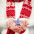 Holding star image of decorative silver toy on female hands Stock Images