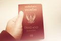Holding valid thai passport close up of Stock Photo