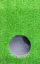 Hole at artificial grass for practice putt Stock Images