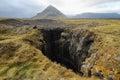 Hole of basalt formations at arnarstapi snaefellsness peninsula iceland Royalty Free Stock Photo