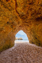 Hole of a big cave algarve portugal in the stones the beach Stock Image