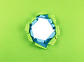 Hole in green and blue paper torn layers Royalty Free Stock Photo