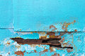 A hole in metal sheet iron blue. The edge of the hole spoiled by Royalty Free Stock Photo