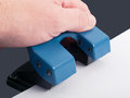 Hole punch drilling with paper studio shot Royalty Free Stock Image