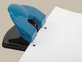 Hole punch drilling with paper studio shot Stock Photo
