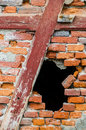 Hole in a red brick wall black Stock Photo