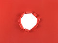 Hole in red paper ripped isolated over a white background Royalty Free Stock Image