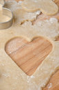Hole in the shape of heart in cookie dough Royalty Free Stock Photo