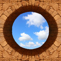 Hole to the sky view through a round of old stone wall Royalty Free Stock Image