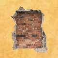 Hole in a wall with red brick background Stock Photography