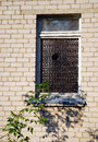 Hole in the window aged with a round glass Royalty Free Stock Photography