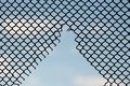 hole in the wire mesh of fence silhouette style