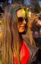 Holi celebrations young girl with glasses celebrating the festival of Royalty Free Stock Image