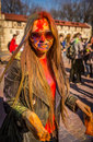 Holi celebrations young girl with glasses celebrating the festival of Royalty Free Stock Photography