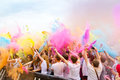 Holi gaudy festival stuttgart may th dancing people with color powder on the in at Stock Photography