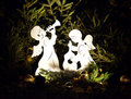 Holiday Angels in Pine Boughs Royalty Free Stock Photo