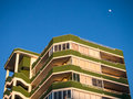 Holiday apartments in early evening light with a rising moon malaga spain Stock Image