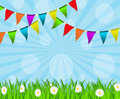 Holiday background with multicolored flags and grass with daisies Stock Photo