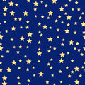 Holiday background seamless pattern of gold stars on a blue Royalty Free Stock Photos