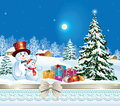 Holiday banner with a christmas tree and snowmen in the winter landscape Stock Photos