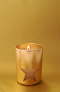 Holiday candle with star and copy space christmas on gold background Stock Photography