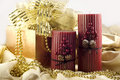 Holiday Candles with Gold Decorations Stock Photo