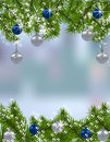 Holiday card. Green fir branches with silver and blue balls in the real background. Up and down. Christmas decorations Royalty Free Stock Photo