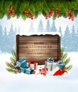 Holiday Christmas background with a gift boxes and Santa hat.