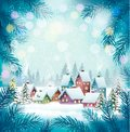 Holiday Christmas background with a village and trees. Royalty Free Stock Photo