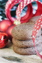 Holiday cookies and christmas bauble ribbon Royalty Free Stock Images