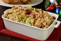 Holiday cranberry stuffing a baking pan of iwth and celery on a christmas table Royalty Free Stock Images