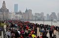 Holiday crowds throng the bund in shanghai china february popular and historic pudong riverfront area known as on left can be Royalty Free Stock Photos