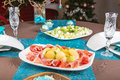 Holiday decorated table christmas tree ham and melone and sal salad Royalty Free Stock Image