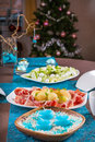 Holiday decorated table christmas tree ham and melone and sal salad Stock Photography