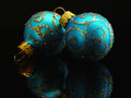 Holiday decoration in blue and gold with reflection and copy space Royalty Free Stock Photos