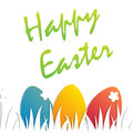 Holiday easter background. The colored eggs on the grass. Easter card with place for text.