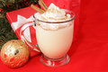 Holiday eggnog with copyspace mug of delicious topped whipped cream nutmeg and cinnamon sticks for christmas Stock Photography