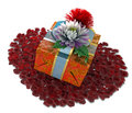 Holiday flowers with gift box and rose petals Royalty Free Stock Photos