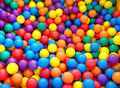 Holiday a games room children s party box filled with small colored balls Royalty Free Stock Photos