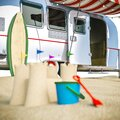 Holiday getaway with a sand castle out of focus Royalty Free Stock Photo