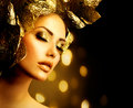 Holiday golden makeup fashion glamour gold make up Stock Image
