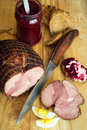 Holiday ham with fresh crusty bread , eggs and condiments Royalty Free Stock Photo