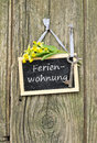 Holiday home chalkboard key and cowslips with lettering Stock Photography