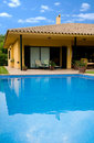 Holiday home with a pool Royalty Free Stock Images