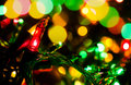 Holiday lights multicolored shining in the dark Stock Images