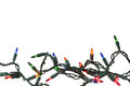 Holiday lights a string of colorful on a white background Royalty Free Stock Photos