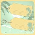 Holiday luggage tags with palm trees flipflops and sun on a green flipflop background Royalty Free Stock Photo
